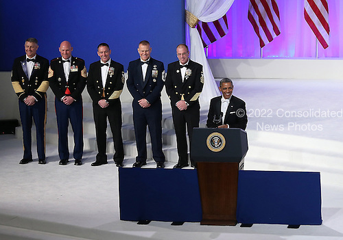 United States President Barack Obama (R) delivers remarks at the Commander-in-Chief Ball on January 21, 2013 in Washington, DC. Pres. Obama was sworn-in for his second term as president during a public ceremonial inauguration earlier in the day. .Credit: Justin Sullivan / Pool via CNP