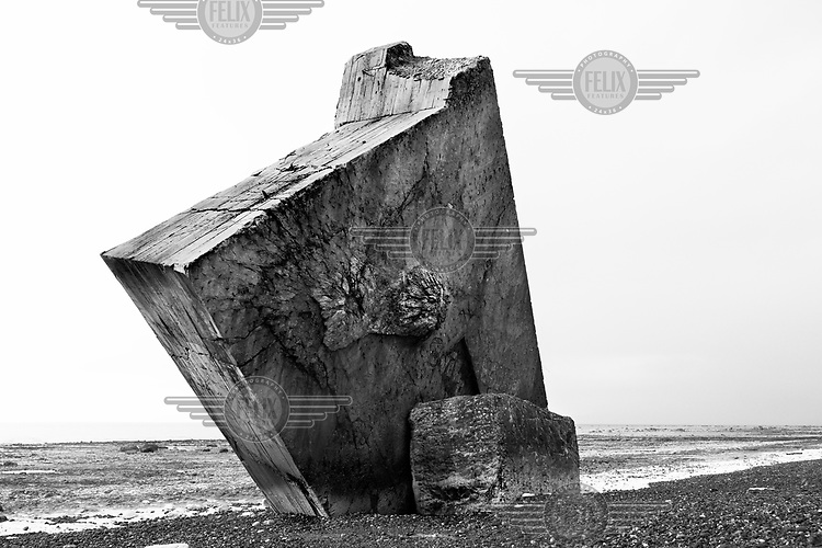 A piece of a concrete defensive structure juts out of the ground along a beach in France along the route of the Atlantic Wall (Atlantikwall in German).The Atlantic Wall (or Atlantikwall in German) was a system of defensive structures built by Nazi Germany between 1942 and 1945, stretching over 1,670 miles (2,690 km) along the coast from the North of Norway to the border between France and Spain at the Pyrenees. The wall was intended to repulse an Allied attack on Nazi-occupied Europe and the largest concentration of structures was along the French coast since an invasion from Great Britain was assumed to be most likely. Slave labour and locals paid a minimum wage were drafted in to supply much of the labour. There are still thousands of ruined structures along the Atlantic coast in all countries where the wall stood except for Germany, where the bunkers were completely dismantled.
