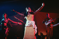 Mali. Bamako. The musician Oumou Sangare sings and dances during a concert at Mamadou Konate stadium. © 1997 Didier Ruef