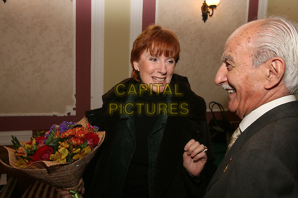 Celia Sandys & Gevork Vartanyan .The Legendary Soviet WWII spy, Gevork Vartanyan, dies at 87, January 10th, 2012.Intelligence service reception. Moscow, October 19th, 2007.half length flowers bouquet black suit brown moustache mustache facial hair .CAP/PER/VV.©VV/PersonaStars/CapitalPictures