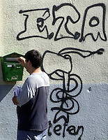 A man walks past near a graffiti in support of ETA in Itsasondo..Photo: Ander Gillenea.