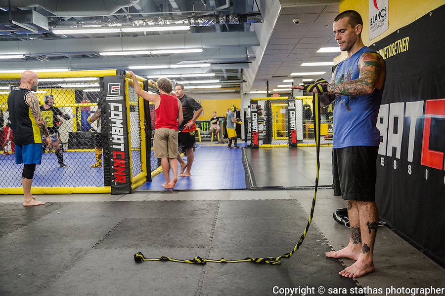 Former WWF Wrestler, CM Punk (Phil Brooks) trains at Roufusport Gym and MMA Academy in Milwaukee, Wisconsin.