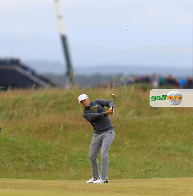 Jordan Spieth (USA) chips into the 14th green during Sunday's Round 3 of the 144th Open Championship, St Andrews Old Course, St Andrews, Fife, Scotland. 19/07/2015.<br /> Picture Eoin Clarke, www.golffile.ie