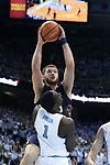 CHAPEL HILL, NC - FEBRUARY 12: Notre Dame's Martinas Geben (LTU) (behind) charges into North Carolina's Theo Pinson (1). The University of North Carolina Tar Heels hosted the University of Notre Dame Fighting Irish on February 12, 2018 at Dean E. Smith Center in Chapel Hill, NC in a Division I men's college basketball game. UNC won the game 83-66.