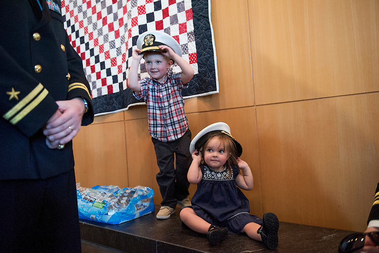 UNITED STATES - SEPTEMBER 07: Pierson Kennedy, 4, and his sister Charlotte, 2, play with Navy covers after a graveside service for Women Airforce Service Pilot (WASP) Elaine Harmon, at Arlington National Cemetery, September 7, 2016. Citing space issues, WASPs were initially ineligible for inclusion at Arlington, but after a petition challenging the rule President Obama signed legislation that reversed it. Elaine Harmon passed away last year at age 95. (Photo By Tom Williams/CQ Roll Call)