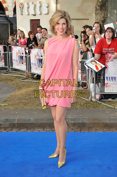 "CHRISTINE BARANSKI.""Mamma Mia!"" world film premiere.Odeon Cinema, Leicester Square, London, England.30th June 2008.arrivals full length pink dress sleeveless draped gold pointy shoes clutch bag .CAP/PL.©Phil Loftus/Capital Pictures"