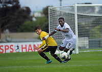 Callan Elliot (left) and Ahinga Selemani compete for the ball during the ISPS Handa Premiership football match between Wellington Phoenix Reserves and Hawkes Bay United at Porirua Park in Wellington, New Zealand on Sunday, 10 November 2019. Photo: Dave Lintott / lintottphoto.co.nz
