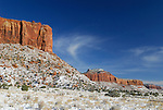 Red sandstone cliffs above the Beef Basin Rd on a snow morning in Indian Creek, UT.
