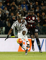 Calcio, Serie A: Juventus vs Milan. Torino, Juventus Stadium, 21 novembre 2015. <br /> Juventus&rsquo; Paul Pogba, left, is challenged by AC Milan&rsquo;s M&rsquo;Baye Niang during the Italian Serie A football match between Juventus and AC Milan at Turin's Juventus stadium, 21 November 2015. Juventus won 1-0.<br /> UPDATE IMAGES PRESS/Isabella Bonotto