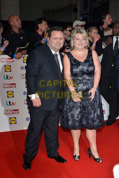 Paul Potts &amp; Julie Ann<br /> The Daily Mirror's Pride of Britain Awards arrivals at the Grosvenor House Hotel, London, England.<br /> 7th October 2013<br /> full length black suit blue dress <br /> CAP/PL<br /> &copy;Phil Loftus/Capital Pictures