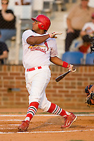 Left fielder Jairo Martinez (28) of the Johnson City Cardinals follows through on his swing at Howard Johnson Field in Johnson City, TN, Thursday July 3, 2008.