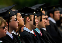 Graduates listen to speakers during Graduation Ceremony at Belmont Abbey College in Belmont, NC.