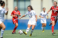 26 September 2010:  FIU's Kelly Ann Hutchinson (12) kicks the ball upfield in the second half as the FIU Golden Panthers defeated the Arkansas State Red Wolves, 1-0 in double overtime, at University Park Stadium in Miami, Florida.