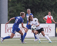 Portland Thorns FC forward Alex Morgan (13) passes the ball as Boston Breakers midfielder Joanna Lohman (11) closes. In a National Women's Soccer League (NWSL) match, Portland Thorns FC (white/black) defeated Boston Breakers (blue), 2-1, at Dilboy Stadium on July 21, 2013.