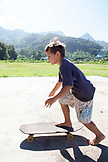 FRENCH POLYNESIA, Moorea. Local kids skateboarding and biking.