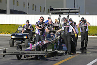 Feb. 14, 2013; Pomona, CA, USA; NHRA crew members for top fuel dragster driver Leah Pruett during qualifying for the Winternationals at Auto Club Raceway at Pomona.. Mandatory Credit: Mark J. Rebilas-