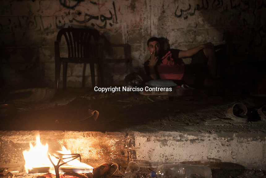 """In this Sunday, Aug. 17, 2014 photo, a Palestinian youth rests in the streets of the Shuyaja neighborhood of Gaza City during the five days truce of the ongoing """"Protective Edge"""" Israeli military operation in Gaza Strip. (Photo/Narciso Contreras)"""