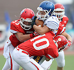 SIOUX FALLS, SD - SEPTEMBER 7: Ben Briggs #25 from O'Gorman is wrapped up by Taylor Salava #33 and Levi Foss #10 from Lincoln in the first quarter of their game at the 2013 Presidents Bowl at Howard Wood Field. (Photo by Dave Eggen/Inertia)