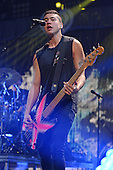 SUNRISE FL - DECEMBER 18: Calum Hood of 5 Seconds Of Summer performs at the Y100 Jingle Ball 2015 held at The BB&T Center on December 18, 2015 in Sunrise, Florida. (Photo by Larry Marano © 2015