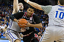December 8, 2013: Shavon Shields (31) of the Nebraska Cornhuskers drives to the basket against Ethan Wragge (34) of the Creighton Bluejays at the CenturyLink Center in Omaha, Nebraska. Creighton defeated Nebraska 82 to 67.