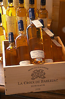Wine shop. Clos l'Envege Monbazillac 2004 on a case La Croix de Barlejac. The town. Saint Emilion, Bordeaux, France