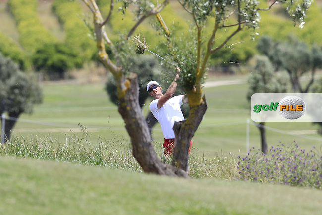 Sebastian Heisele (GER) plays from the rough on the 1st hole during Saturday's Round 3 of the Open de Portugal 2017 at Morgado Golf Resort, Portimao, Portugal. 13th May 2017.<br /> Picture: Eoin Clarke | Golffile<br /> <br /> <br /> All photos usage must carry mandatory copyright credit (&copy; Golffile | Eoin Clarke)