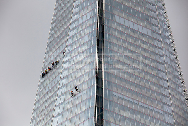 © Licensed to London News Pictures. 16/08/2012. LONDON, UK. Window cleaners dangling from ropes are seen on the Shard, the UK's tallest and newest skyscraper. The  330 metre (1,083 ft) building was completed in April 2012 and opened in July of the same year. Photo credit: Matt Cetti-Roberts/LNP