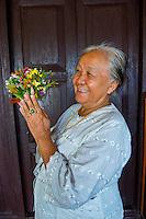 Thailand, Mae Hong Son. Wat Chong Klang Buddhist Monastery. Women preparing flowers.