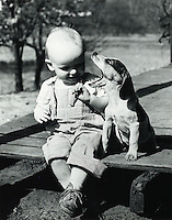 Very young boy with dog. 1950's.