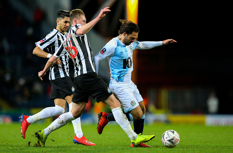 Blackburn Rovers' Bradley Dack battles with Newcastle United's Sean Longstaff and Ayoze Perez<br /> <br /> Photographer Alex Dodd/CameraSport<br /> <br /> Emirates FA Cup Third Round Replay - Blackburn Rovers v Newcastle United - Tuesday 15th January 2019 - Ewood Park - Blackburn<br />  <br /> World Copyright © 2019 CameraSport. All rights reserved. 43 Linden Ave. Countesthorpe. Leicester. England. LE8 5PG - Tel: +44 (0) 116 277 4147 - admin@camerasport.com - www.camerasport.com