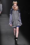 TOKYO, JAPAN - MARCH 21: A model walks the runway at the SHIROMA Autumn/Winter 2012 show during the Japan Fashion Week on March 21, 2012 in Tokyo, Japan.