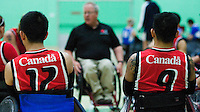 15 AUG 2011 - LEEDS, GBR - Canadian wheelchair rugby team members listen to Head Coach Kevin Orr during a team talk before the  exhibition match against Great Britain (PHOTO (C) NIGEL FARROW)