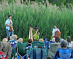 Violinist, Charlie Schikowitz, Harpist, Elizabeth Clark-Jerez, and Cellist, Sharon Penz, of Mamalama, performing at Saugerties Sunset Concert at Glasco Mini Park, NY on Friday, July 1, 2011. Photo © Jim Peppler 2011.