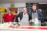 © Joel Goodman - 07973 332324 . . 07/02/2014 .  Manchester , UK . David Neilson , who plays Roy Cropper in Coronation Street , serves behind the counter with Labour candidate Mike Kane on the campaign trail at Jackie's Cafe in Northern Moor , watched by Rob Holuj who owns the cafe , ahead of the Wythenshawe and Sale East by-election . Photo credit : Joel Goodman