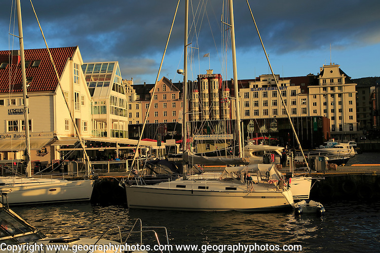 Sailing yachts and historic buildings evening light, Vagen harbour, Bergen, Norway