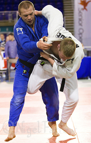 27 MAR 2011 - SHEFFIELD, GBR - Luke McCabe (white) v Robert Forrow (blue) - English Senior Open Judo Championships .(PHOTO (C) NIGEL FARROW)