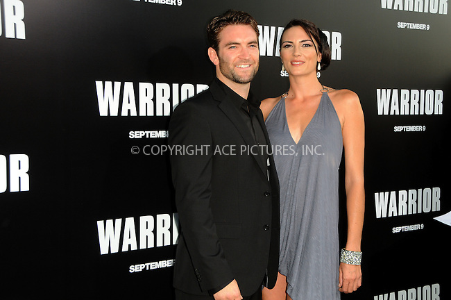WWW.ACEPIXS.COM . . . . .  ....September 6 2011, LA....Actor Sam Hargrave (L) and actress Monique Ganderton arriving at the premiere of 'Warrior' at the Arclight Hollywood on September 6, 2011 in Hollywood, California.....Please byline: PETER WEST - ACE PICTURES.... *** ***..Ace Pictures, Inc:  ..Philip Vaughan (212) 243-8787 or (646) 679 0430..e-mail: info@acepixs.com..web: http://www.acepixs.com