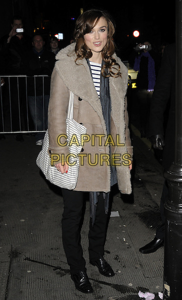 "KEIRA KNIGHTLEY.Leaving after the evening performance of ""The Misanthrope"", The Comedy Theatre, London, England, UK, January 1st 2010..full length beige sheepskin coat lined collar striped top bag shopper tote black shoes flats trousers grey gray scarf .CAP/CAN.©Can Nguyen/Capital Pictures"