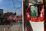 A portrait of Ronald Reagan and flags hang in the window of the museum of the birthplace of Ronald Reagan in Tampico, Illinois on October 26, 2008.   Reagan was born in a modest apartment above a bar with no indoor toilet.