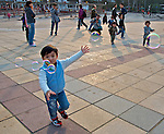 Children chasing and dancing with soap bubbles at Sai Kung, Hong Kong