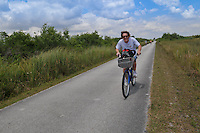 Bicycling the 15-mile loop through Shark Valley, Everglades National State Park, Florida, USA.