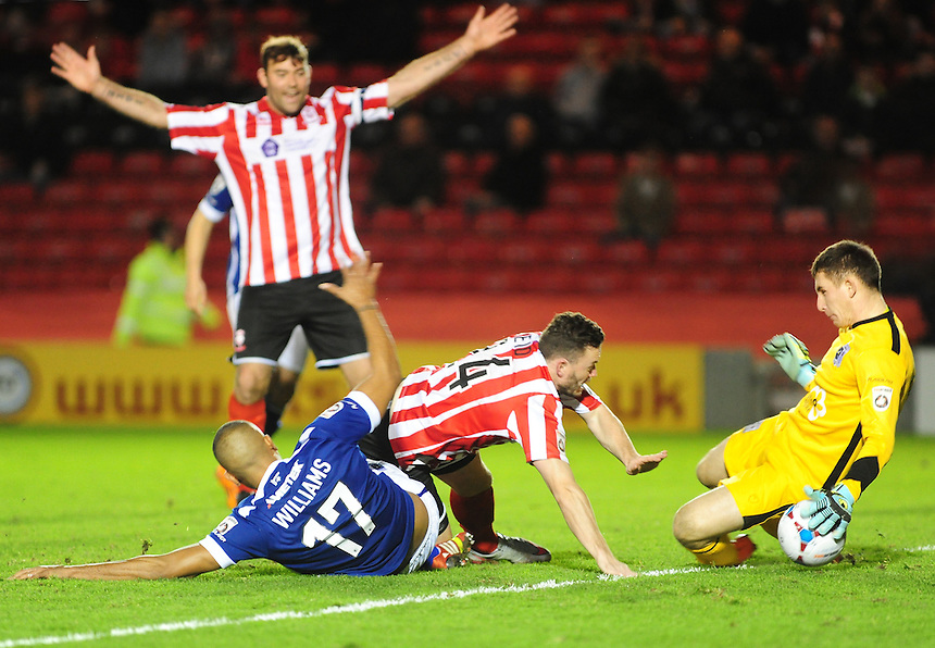 Lincoln City&rsquo;s Craig Reid is tackled by Barrow's Steve Williams but his appeal for a penalty was turned down<br /> <br /> Photographer Andrew Vaughan/CameraSport<br /> <br /> Football - Vanarama National League - Lincoln City v Barrow - Saturday 19th December 2015 - Sincil Bank - Lincoln<br /> <br /> &copy; CameraSport - 43 Linden Ave. Countesthorpe. Leicester. England. LE8 5PG - Tel: +44 (0) 116 277 4147 - admin@camerasport.com - www.camerasport.com
