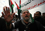 Foreign activists take part in a protest near the Erez border crossing between the northern Gaza Strip and Israel, 31 December 2009. The protest, calling for an end to Israel's blockade on the Gaza Strip, was held simultaneously on both sides of the border. Photo by Mohammed Othman