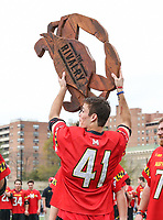 Baltimore, MD - April 28, 2018: Maryland Terrapins Bryce Young (41) holds the Rivalry trophy after the game between John Hopkins and Maryland at  Homewood Field in Baltimore, MD.  (Photo by Elliott Brown/Media Images International)
