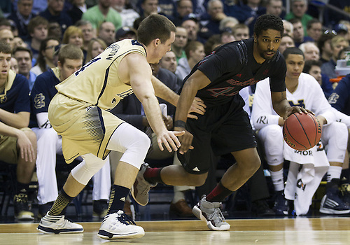 February 24, 2013:  Cincinnati guard JaQuon Parker (44) drives to the basket as Notre Dame guard Pat Connaughton (24) defends during NCAA Basketball game action between the Notre Dame Fighting Irish and the Cincinnati Bearcats at Purcell Pavilion at the Joyce Center in South Bend, Indiana.  Notre Dame defeated Cincinnati 62-41.