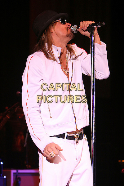 KID ROCK.Performs live in concert at the Carling Apollo in Hammersmith, London, England, UK, November 30th 2008..music live on stage gig half length black hat sunglasses white tracksuit top jacket zip up belt ring necklace microphone buffalo head belt buckle t.CAP/MAR.©Martin Harris/Capital Pictures
