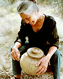 USA, New Mexico, beautiful Native American artist with her pot, Valley of the Wild Roses
