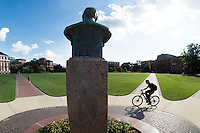 A Mississippi State University student rides his bicycle across the Drill Field on a sunny September afternoon.<br />