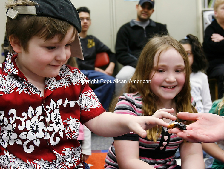PLYMOUTH, CT, 02/19/08- 021909BZ02- Clive Bracken, 5, touches a madascar hissing cockroach held by Sarah Wilby, Animal Program Curator for the Lutz Children's Museum in Manchester, as his sister Shaylin Bracken, 8, looks on during the &quot;Look At Those Legs&quot; program at the Terryville Public Library Thursday. The program also featured live hermit crabs and a crested gecko which the children were allowed to touch.<br /> Jamison C. Bazinet Republican-American