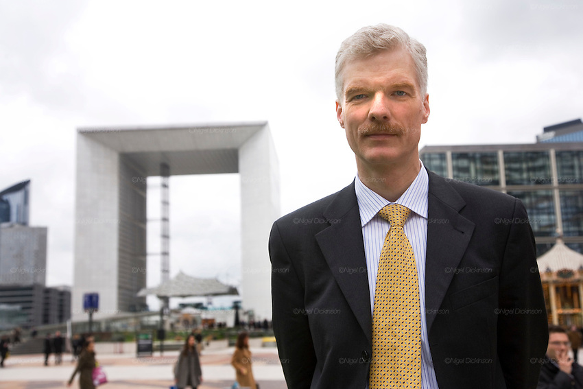 Andreas Schleicher, Head of Division, Indicators and Analysis Dvision, Directorate of education, pictured on the Esplanade of Defense, in the background with the Arche de la Defense , merry-go-round, and Calder sculpture. Paris, March 13th 2008.//Portrait on the Esplanade de la Defense with the Arch and merry go around behind.